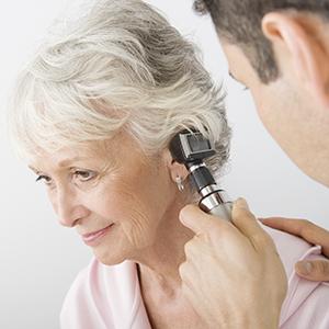 Mid adult doctor examining senior patient